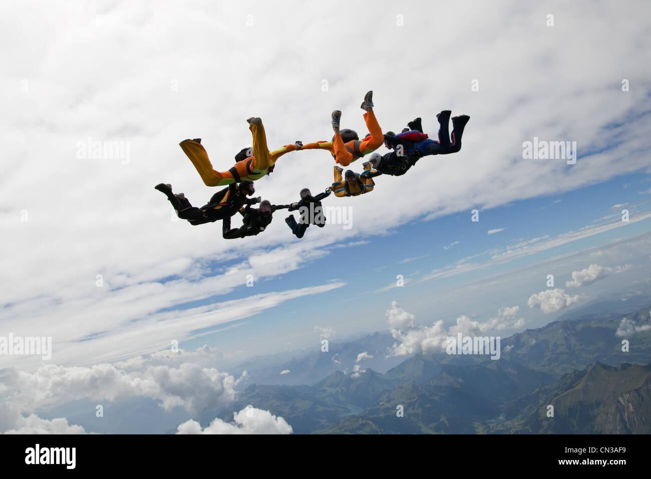 Formation skydivers over Saanen, Switzerland - Stock Image