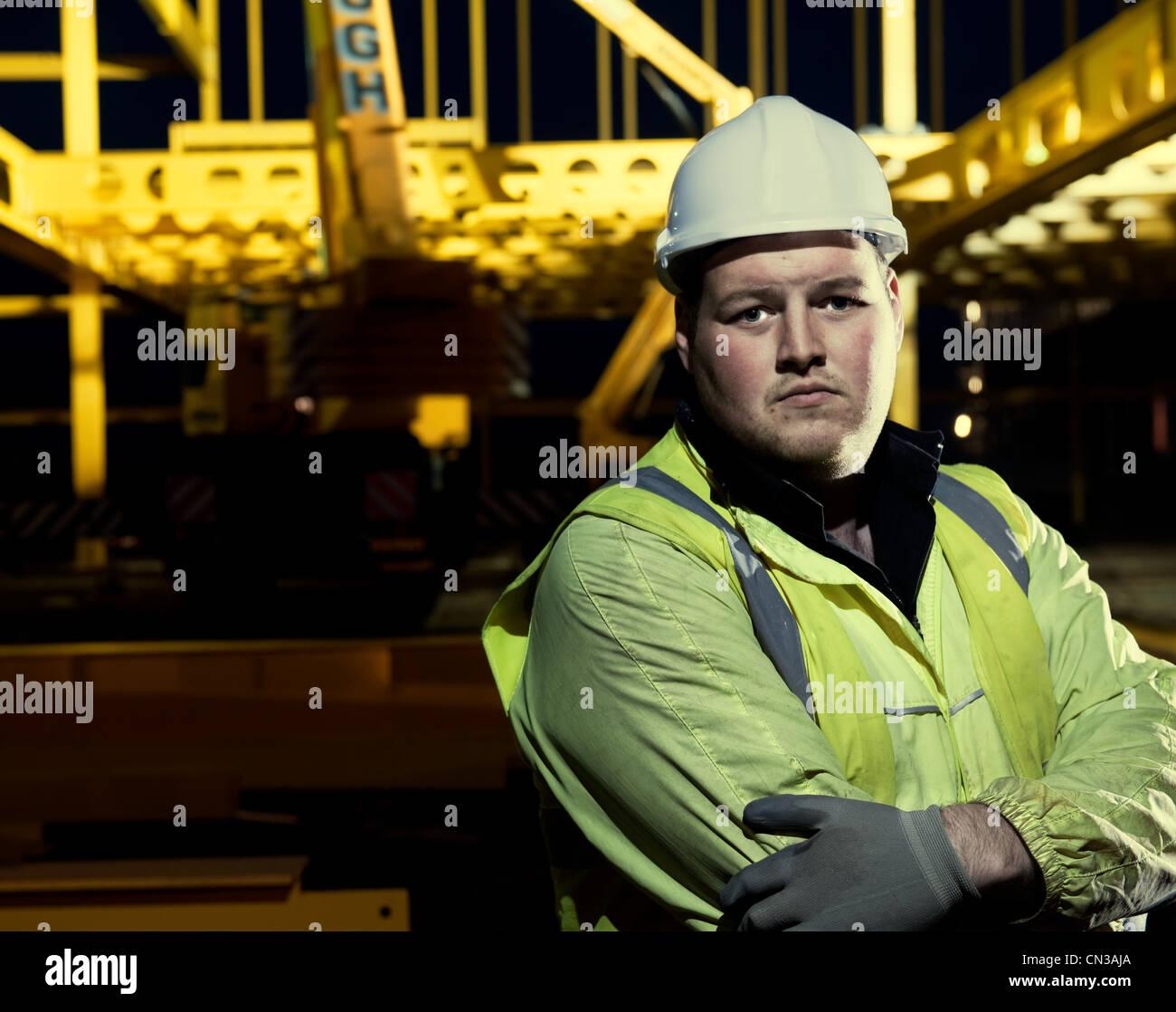 Portrait of builder on construction site Stock Photo