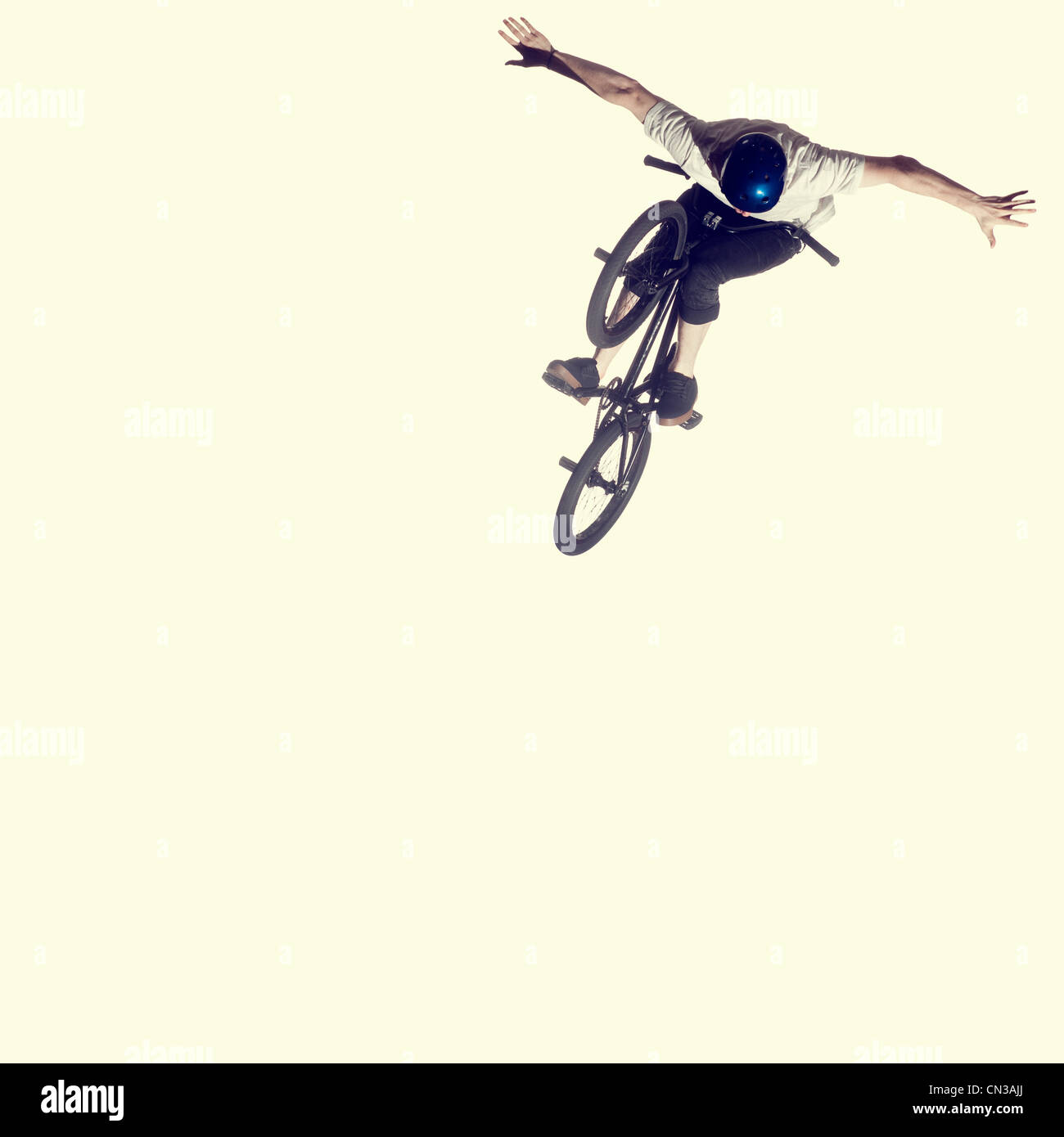 Young man on bmx bike, mid air - Stock Image