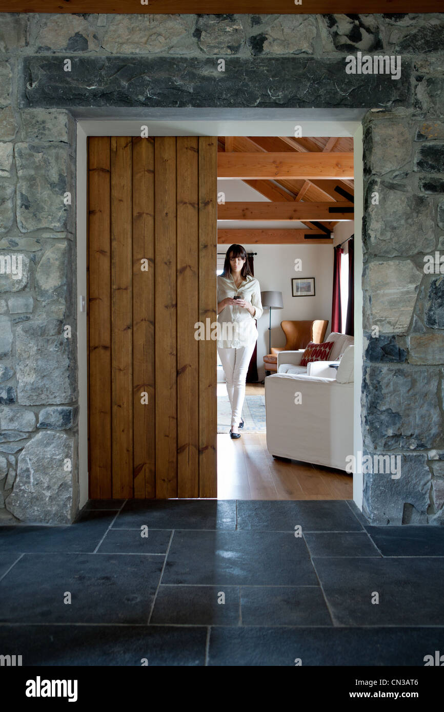 Woman walking in modern home interior - Stock Image