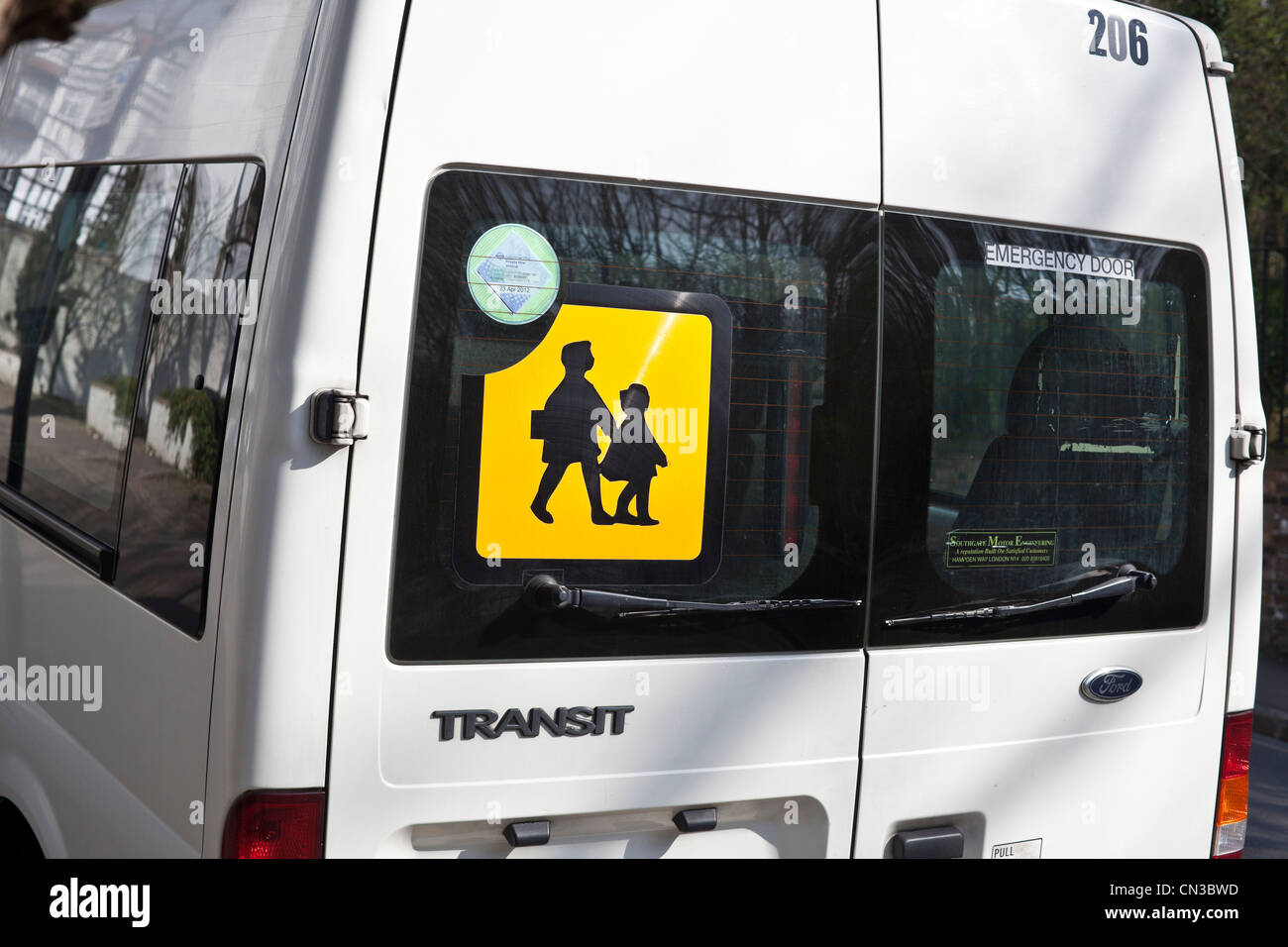 32e1f7c17c Rear view of a van displaying a school children sign