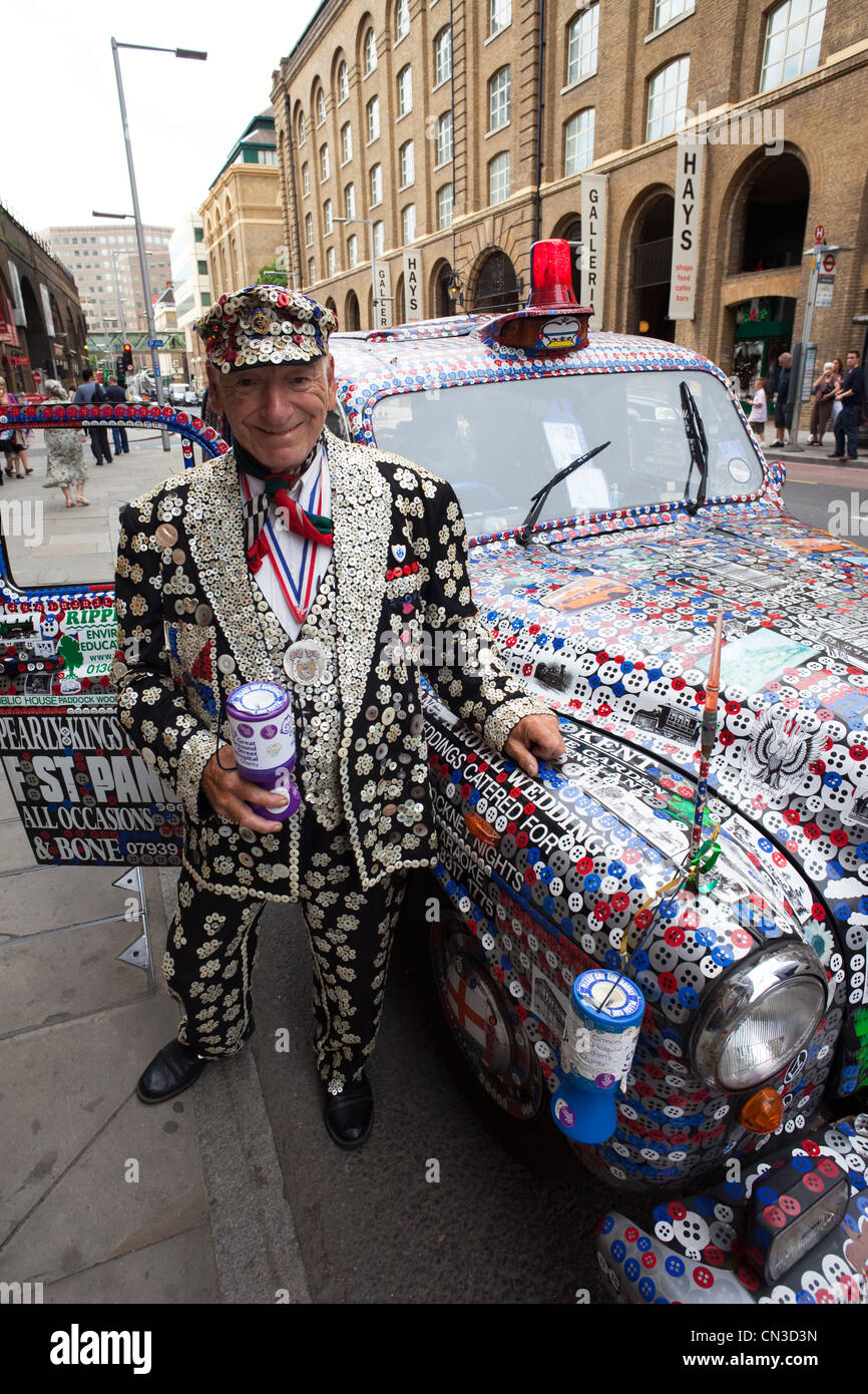 England, London, Pearly King and Decorated London Taxi - Stock Image