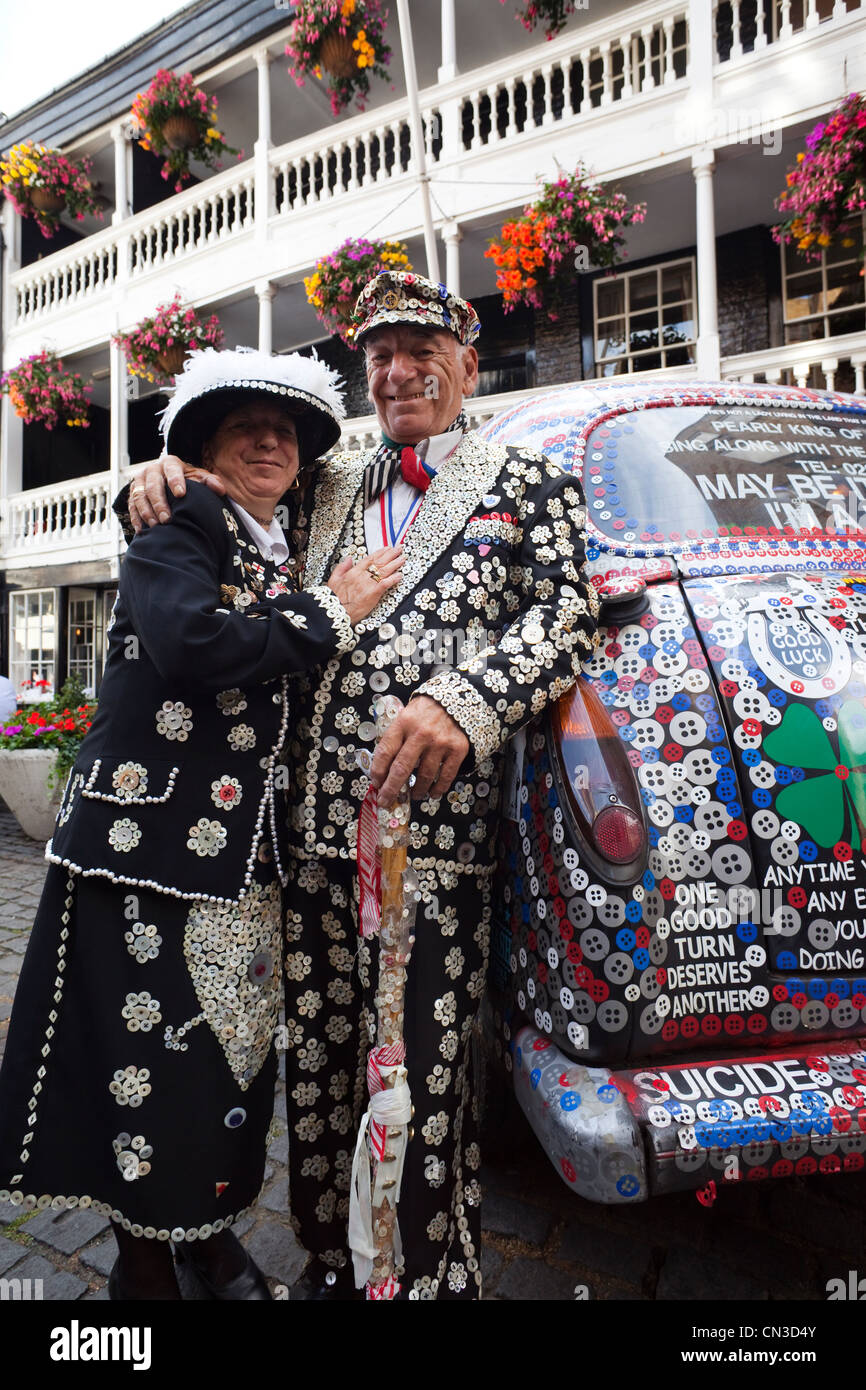 England, London, Pearly King and Queen and Decorated London Taxi - Stock Image