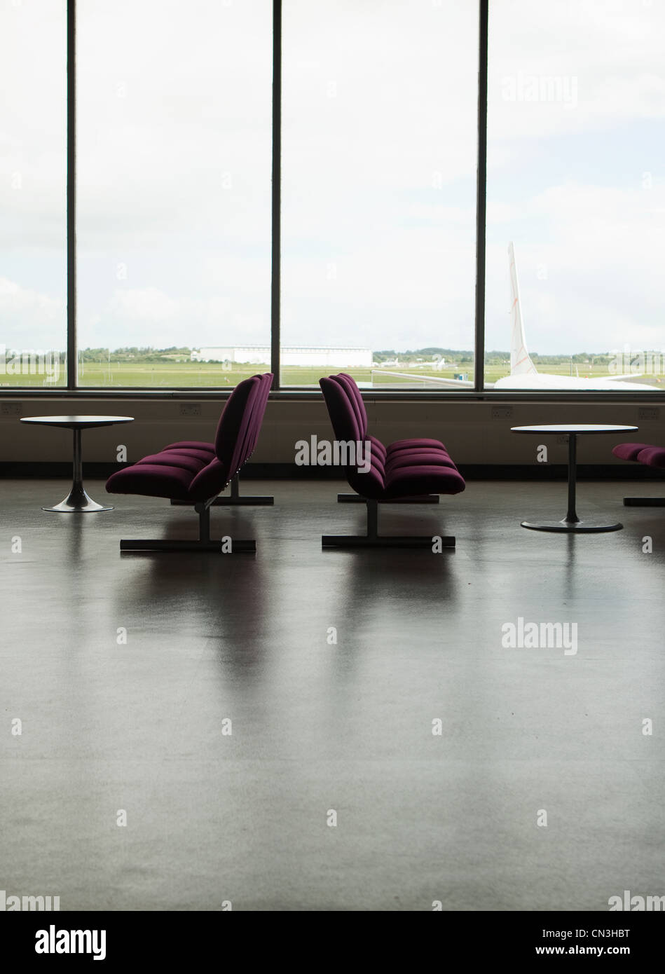Empty chairs in airport Stock Photo