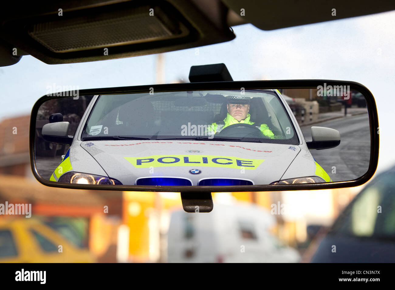view in view view mirror Traffic Police Car drink driving Christmas campaign Officer BMW flashing lights blue Britain - Stock Image