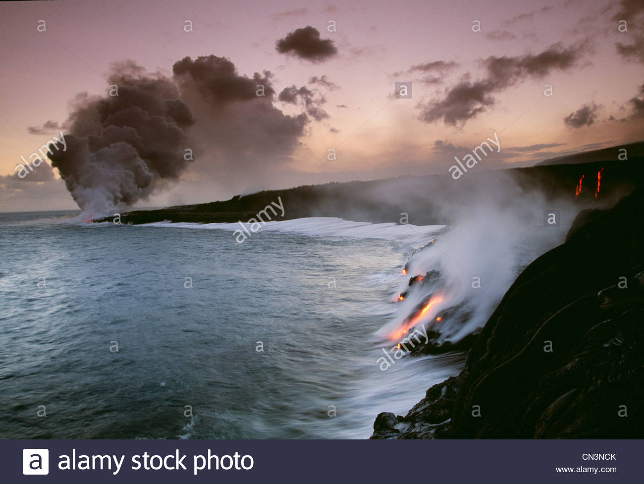 Lava flows entering the ocean, Hawaii Volcanoes National Park, Hawaii - Stock Image