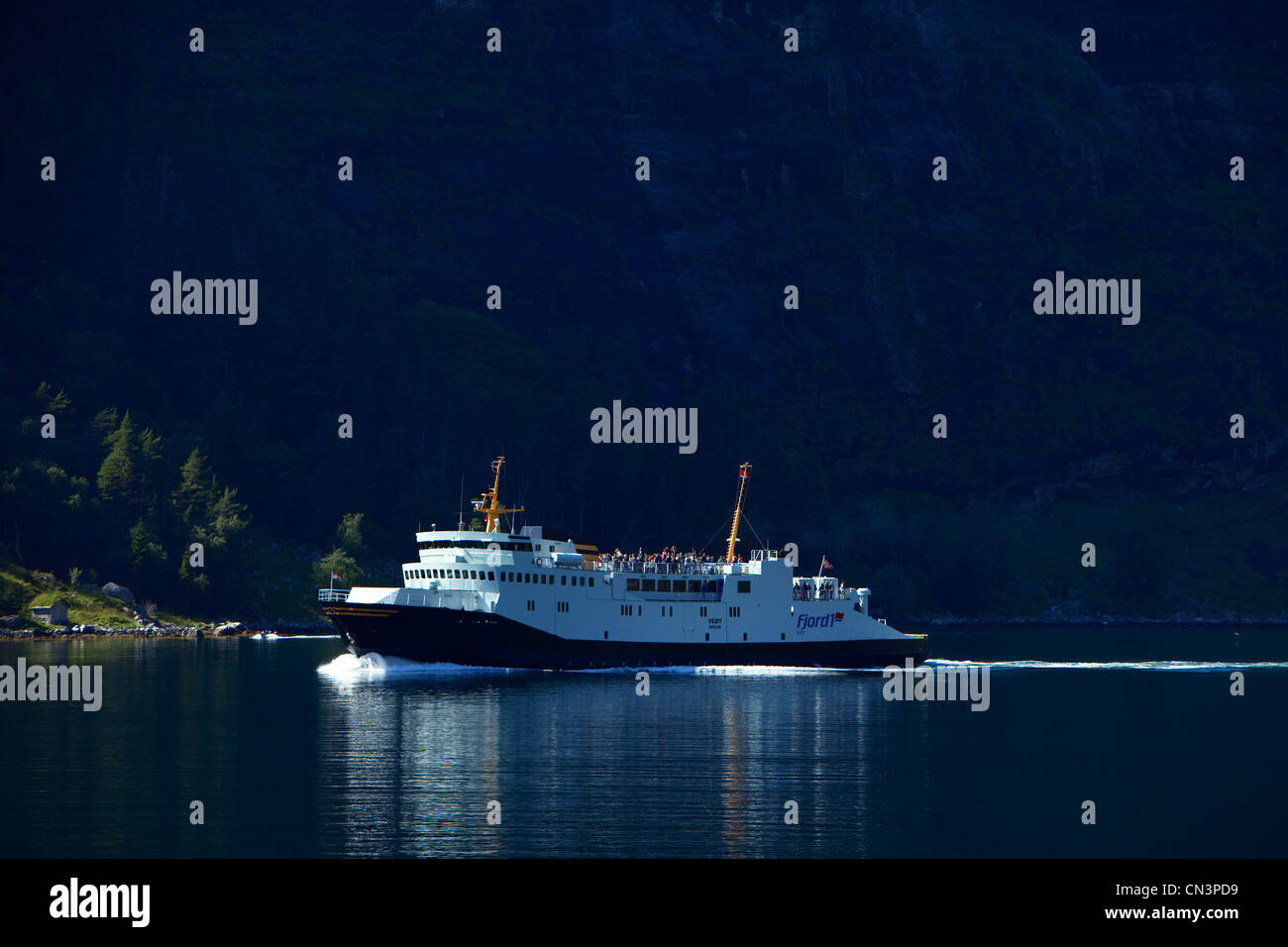 Norway, Sunnmore Region, More og Romsdal County, Geirangerfjord listed as World Heritage by UNESCO, ferry arriving - Stock Image