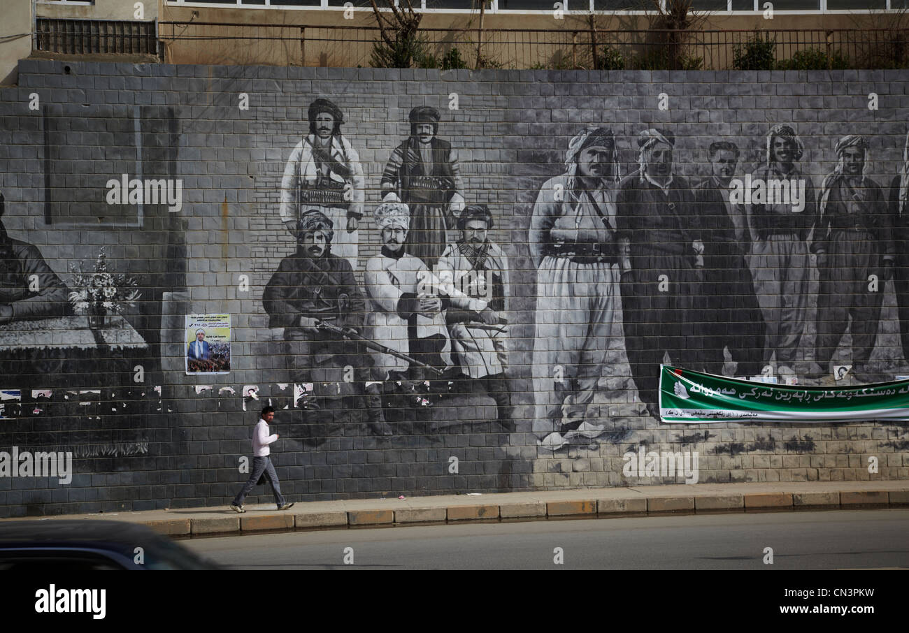 Paintings on the walls of important events and personalities in Suleimaniya of Iraqi Kurdistan - Stock Image