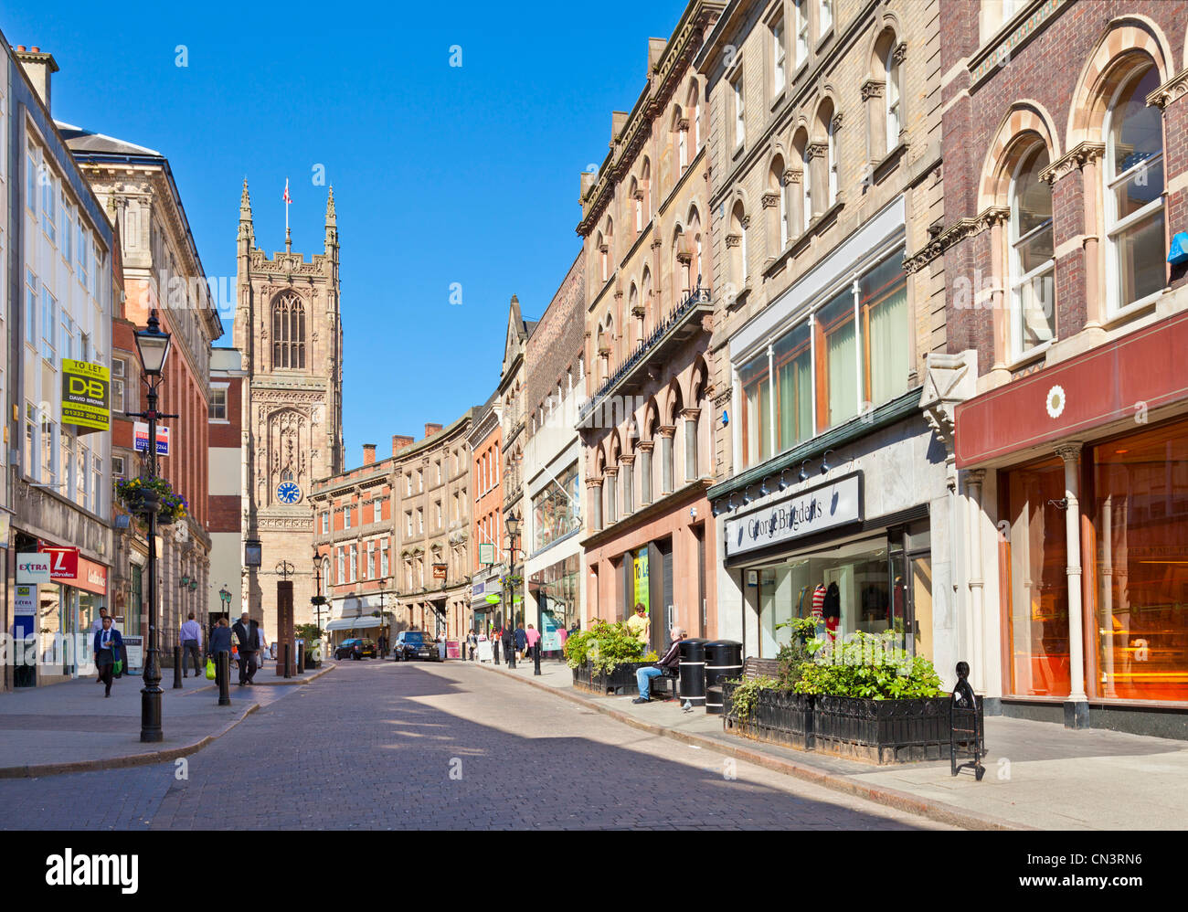 Irongate shops Derby city centre looking towards the cathedral Derby Derbyshire England UK GB EU Europe - Stock Image