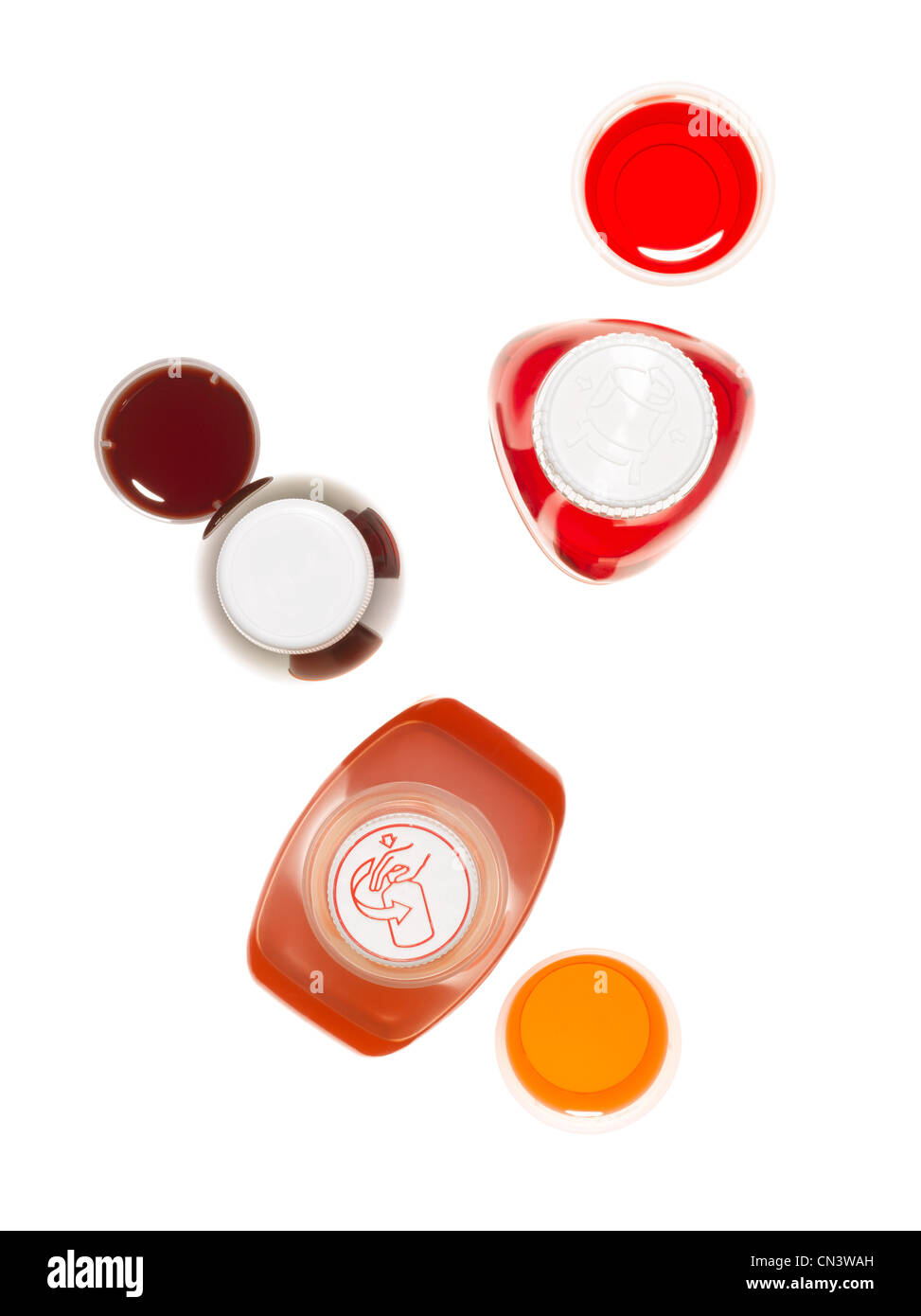 Overhead view of cough syrup bottles - Stock Image