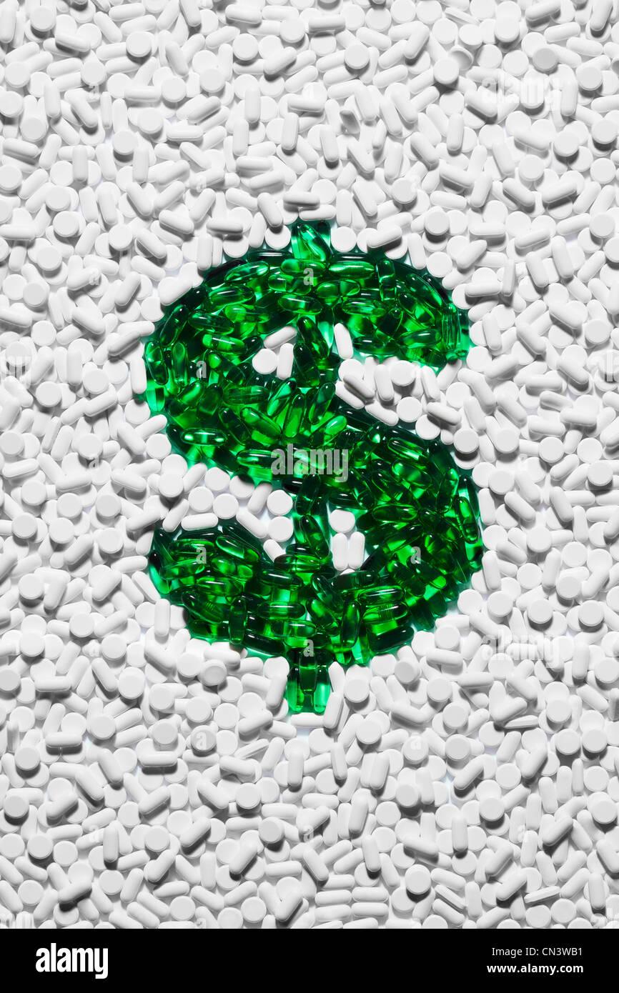 Green dollar sign made up of pills - Stock Image