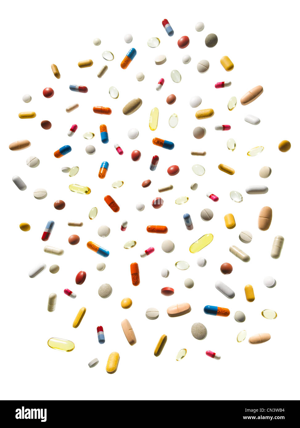 Multicoloured pills against white background - Stock Image
