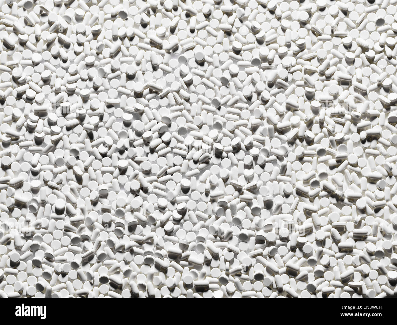 Large group of white tablets - Stock Image