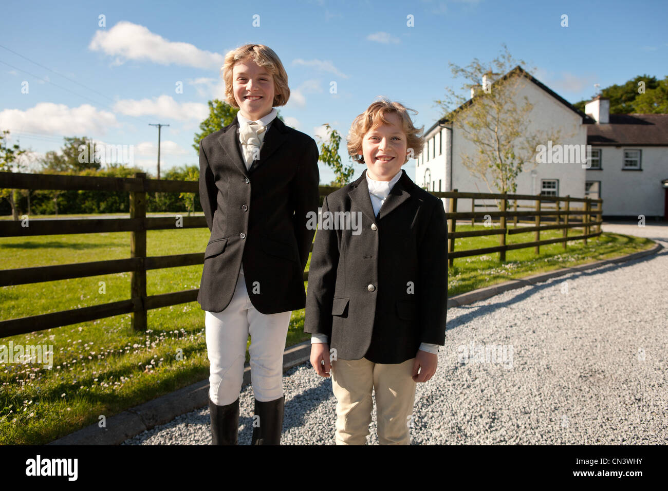 Portrait Of Boys Wearing Horse Riding Clothes Stock Photo Alamy
