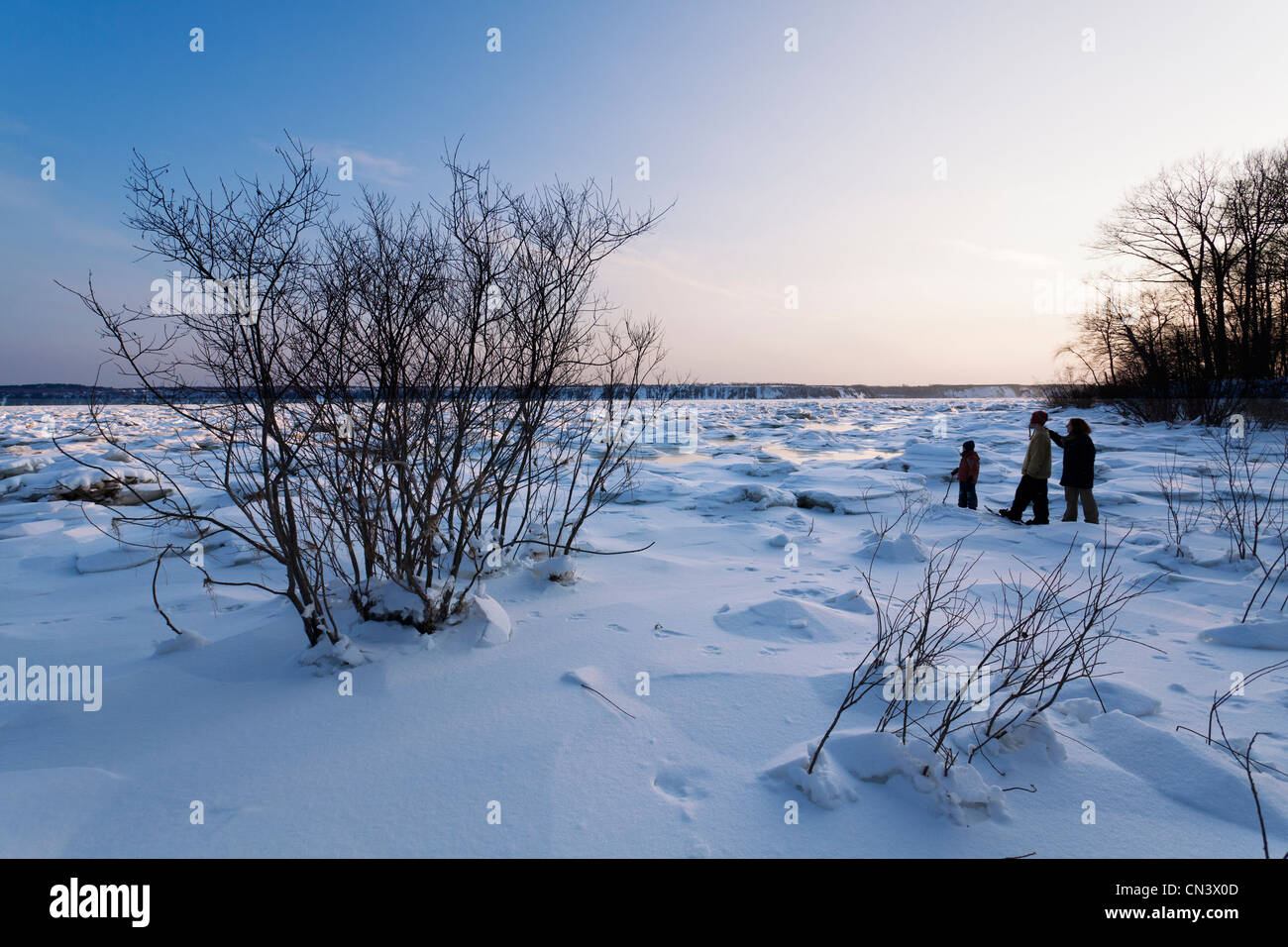 Canada, Quebec province, Quebec, the banks of the St Lawrence River frozen in winter, family snowshoe hike - Stock Image