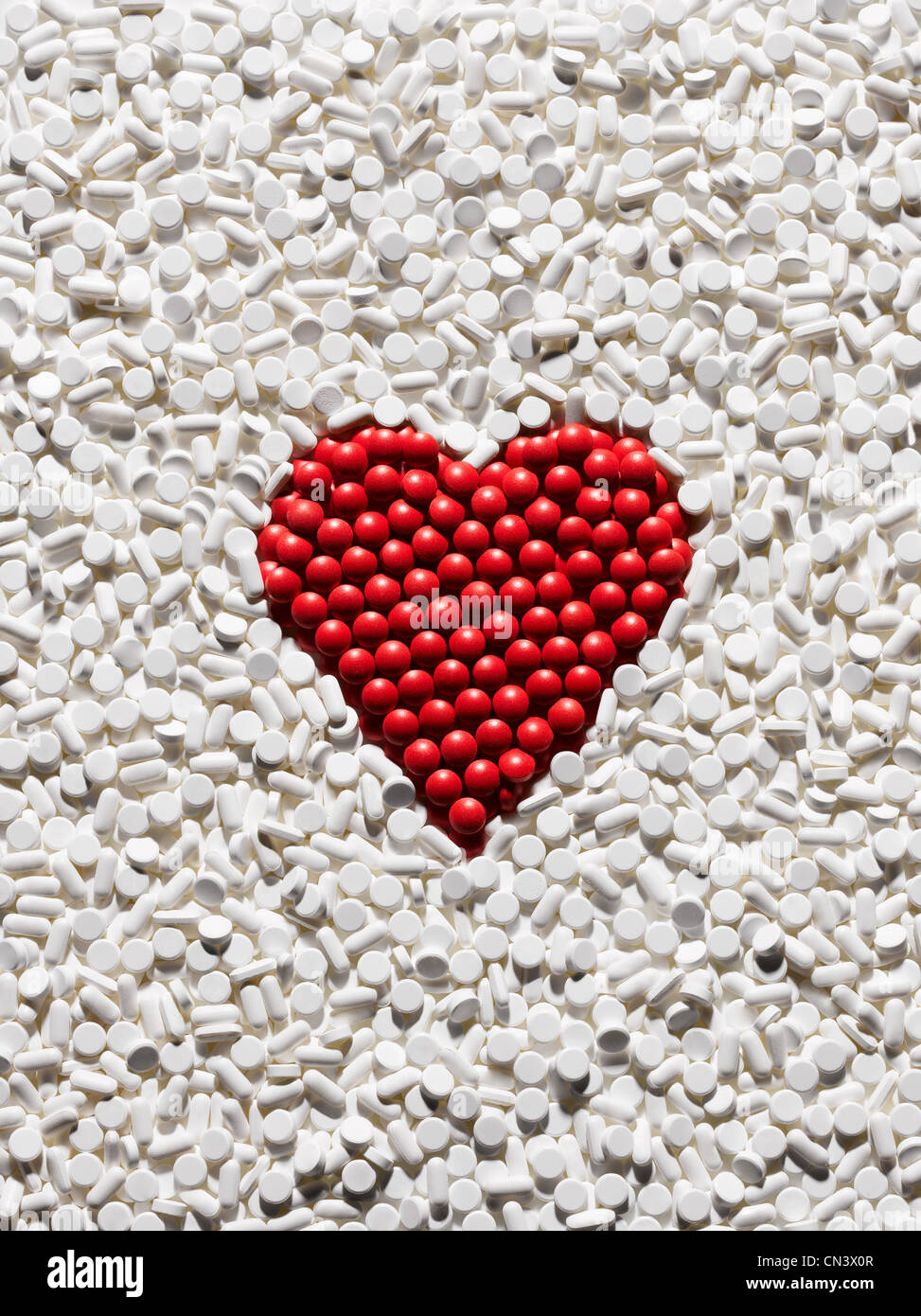 Red pills arranged into heart shape Stock Photo