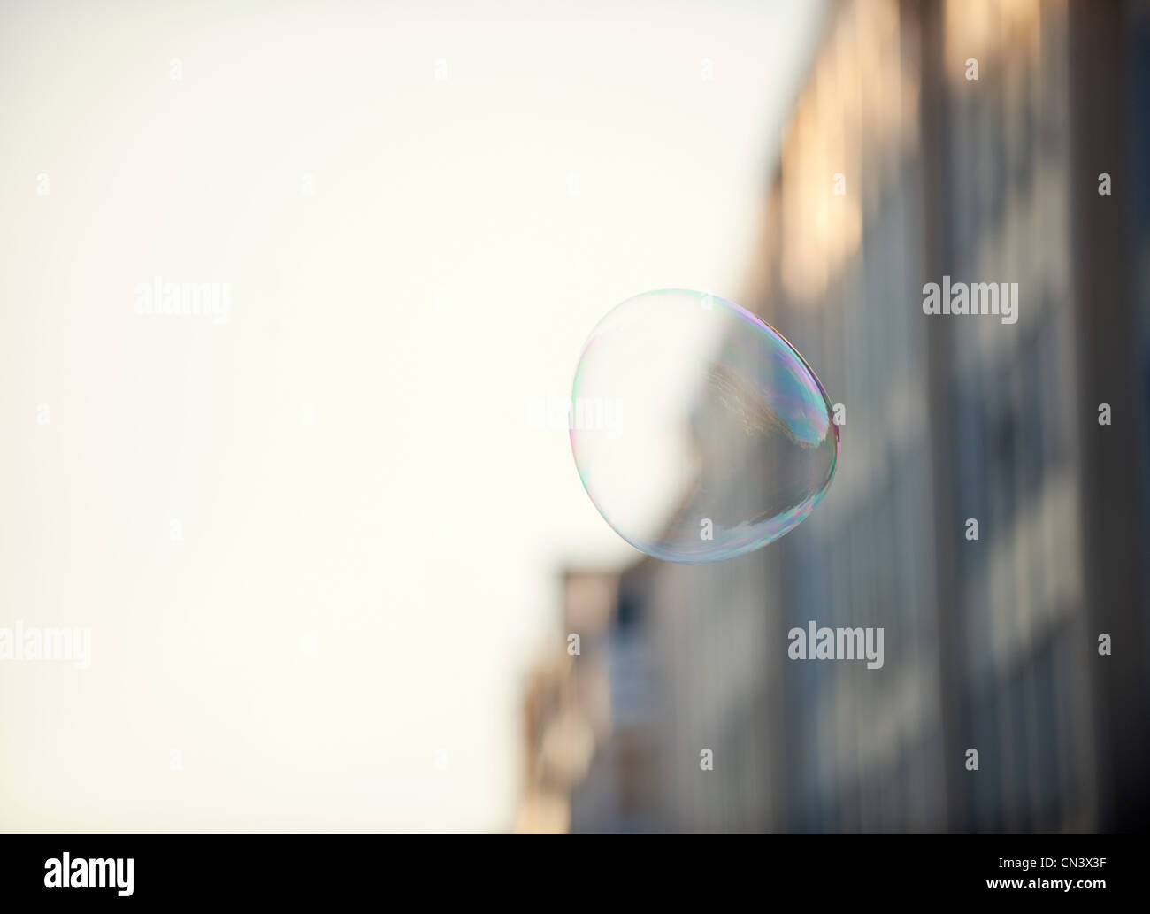 A bubble floating in an urban environment - Stock Image