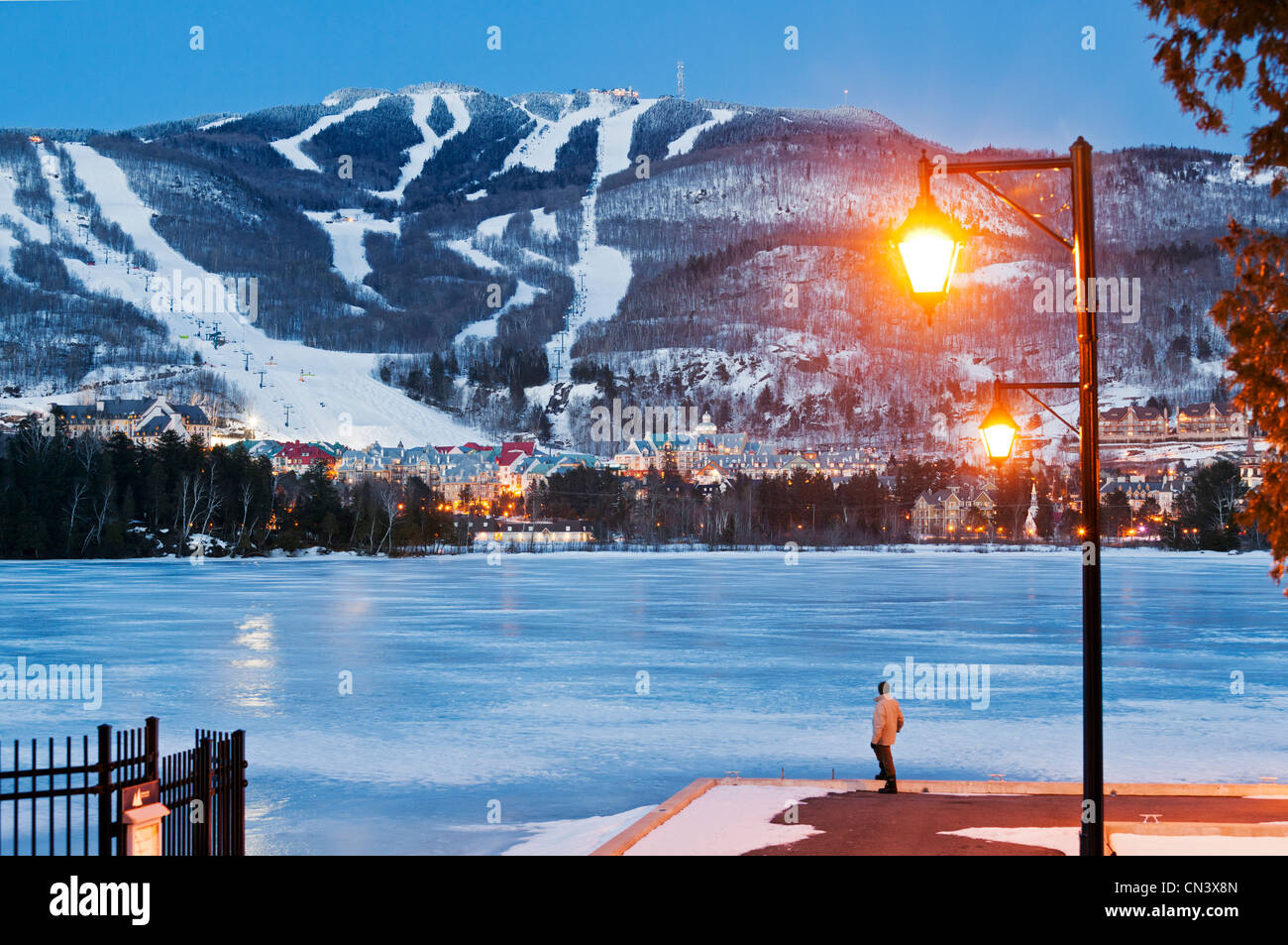 Canada, Quebec province, Laurentians region, Mont Tremblant, ski resort and ski slopes lit at night seen from the - Stock Image
