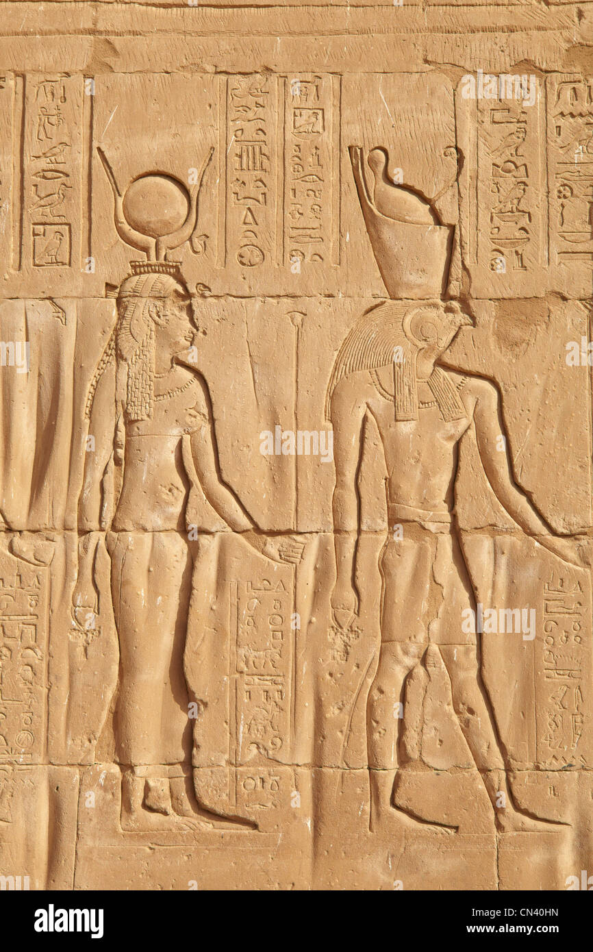 Egypt - Edfu, Temple of Horus, detail of the relief of Isis and Osiris - Stock Image
