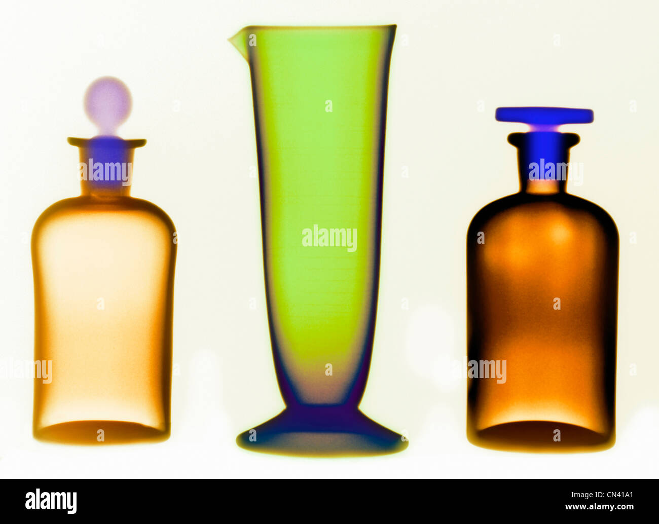 colorized x-ray of glassware bottles - Stock Image