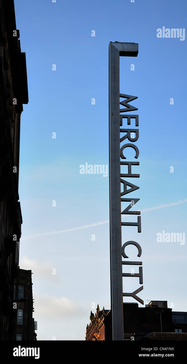 Merchant City marker post silhouetted against a blue sky - Stock Image