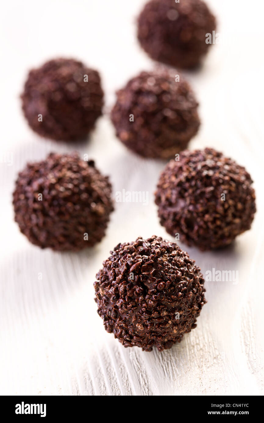 chocolate truffles on kitchen table - Stock Image