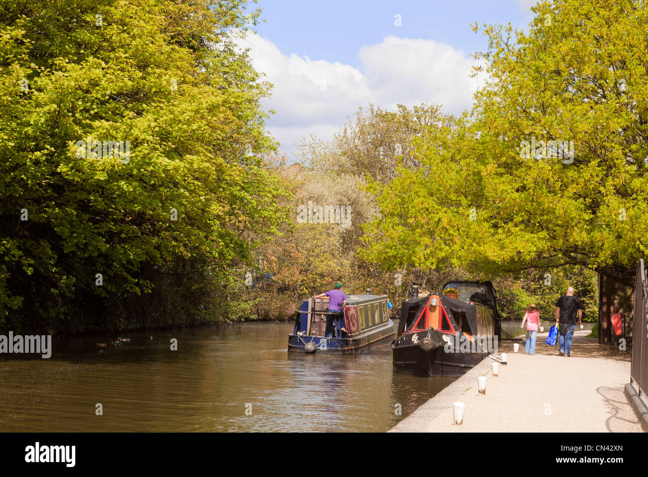 Narrowboats on the River Severn at Worcester, England, in spring. - Stock Image