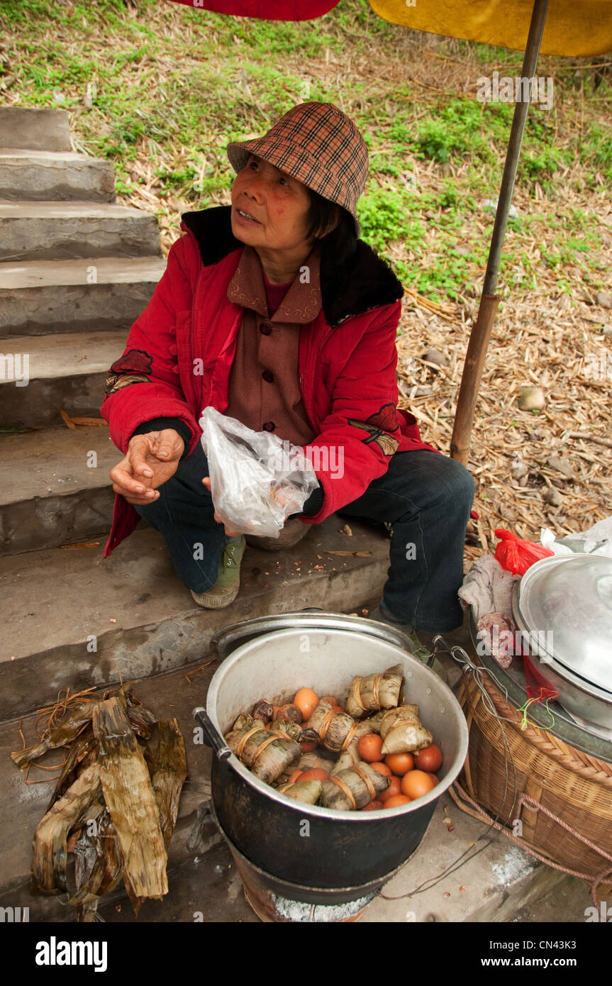 A woman selling boiled eggs, Yangdi, Guilin, Guangxi Province, Southern China Stock Photo