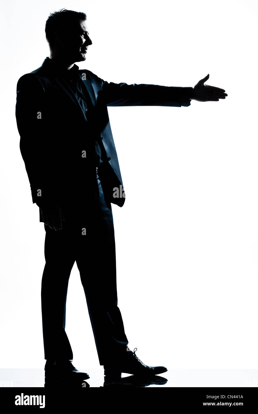 one caucasian man handshake profile  full length silhouette in studio isolated white background - Stock Image