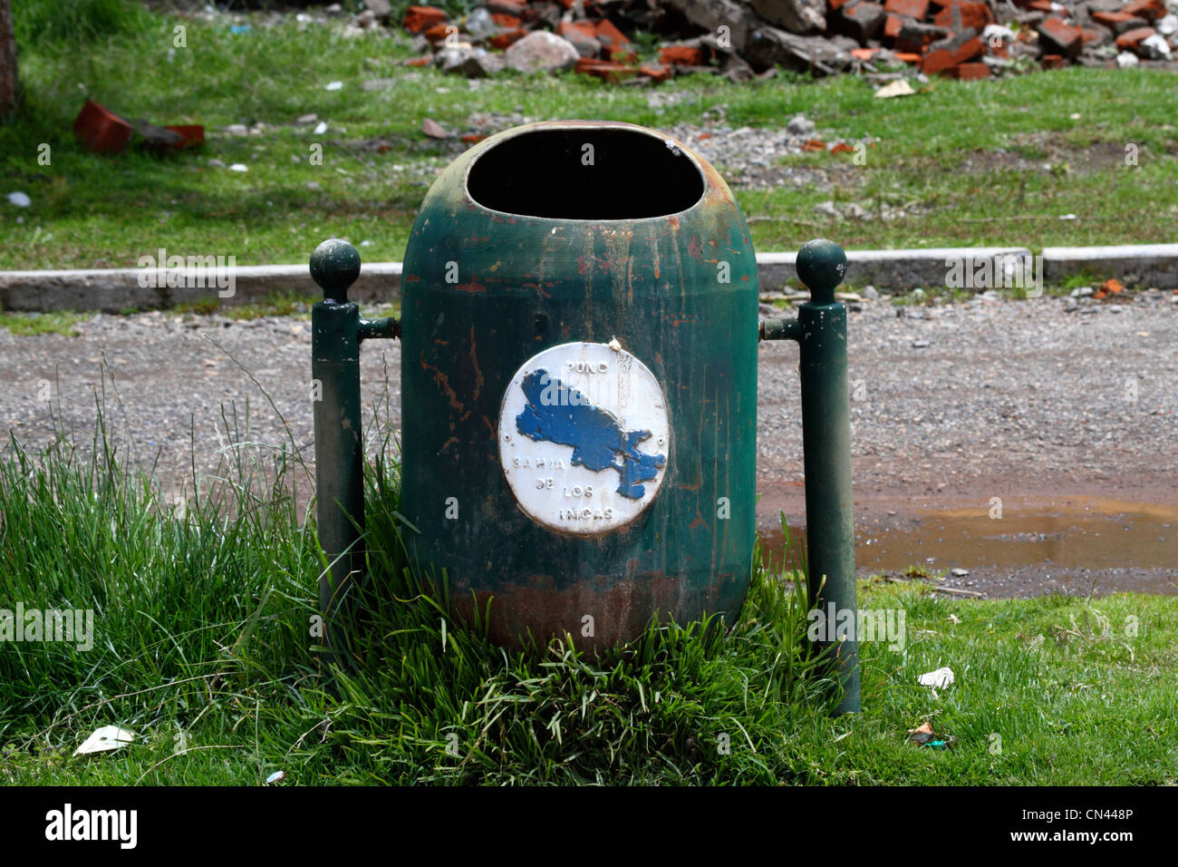 Rubbish bin with outline of Lake Titicaca , part of a campaign to keep the Lake tidy , Puno , Peru - Stock Image