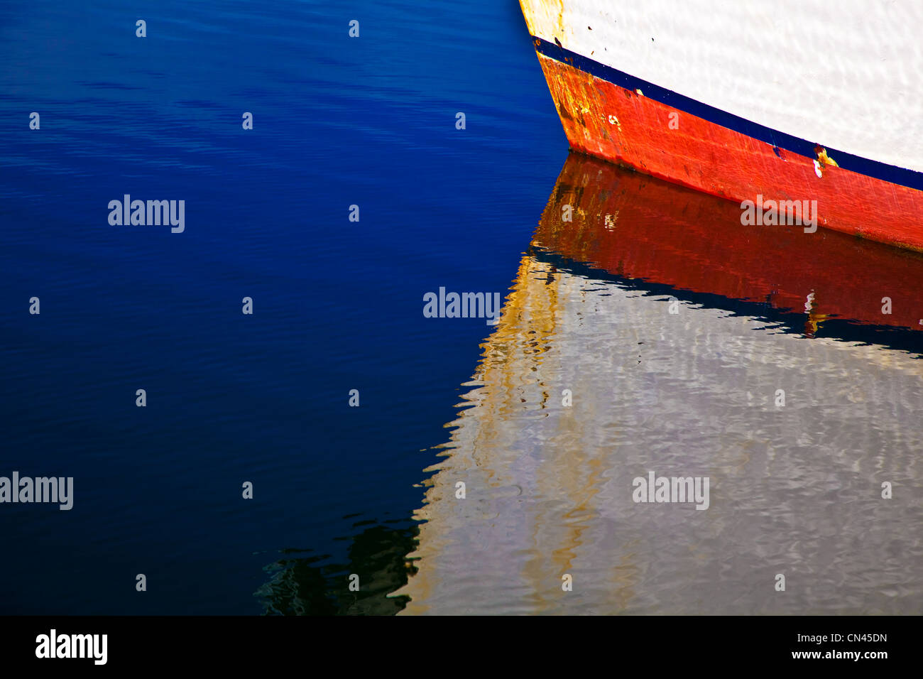 Reflection of boat bow in water - Stock Image