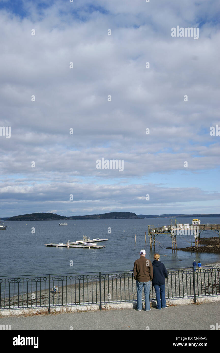 Full-length rear view of couples enjoying the view from the promenade and beach in Bar Harbor, Maine. - Stock Image