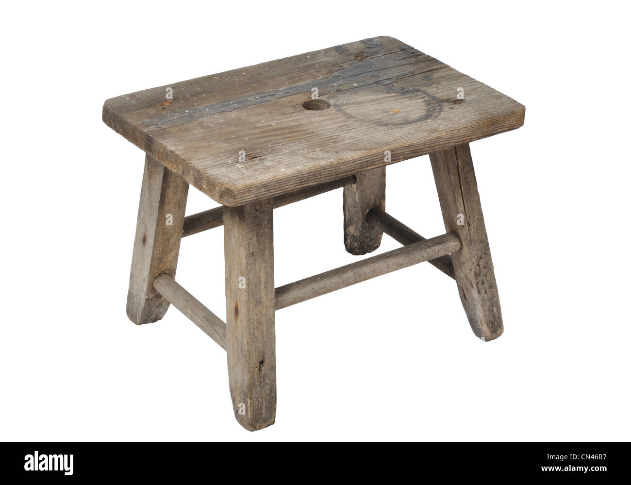 Old wooden stool isolated on white background - Stock Image