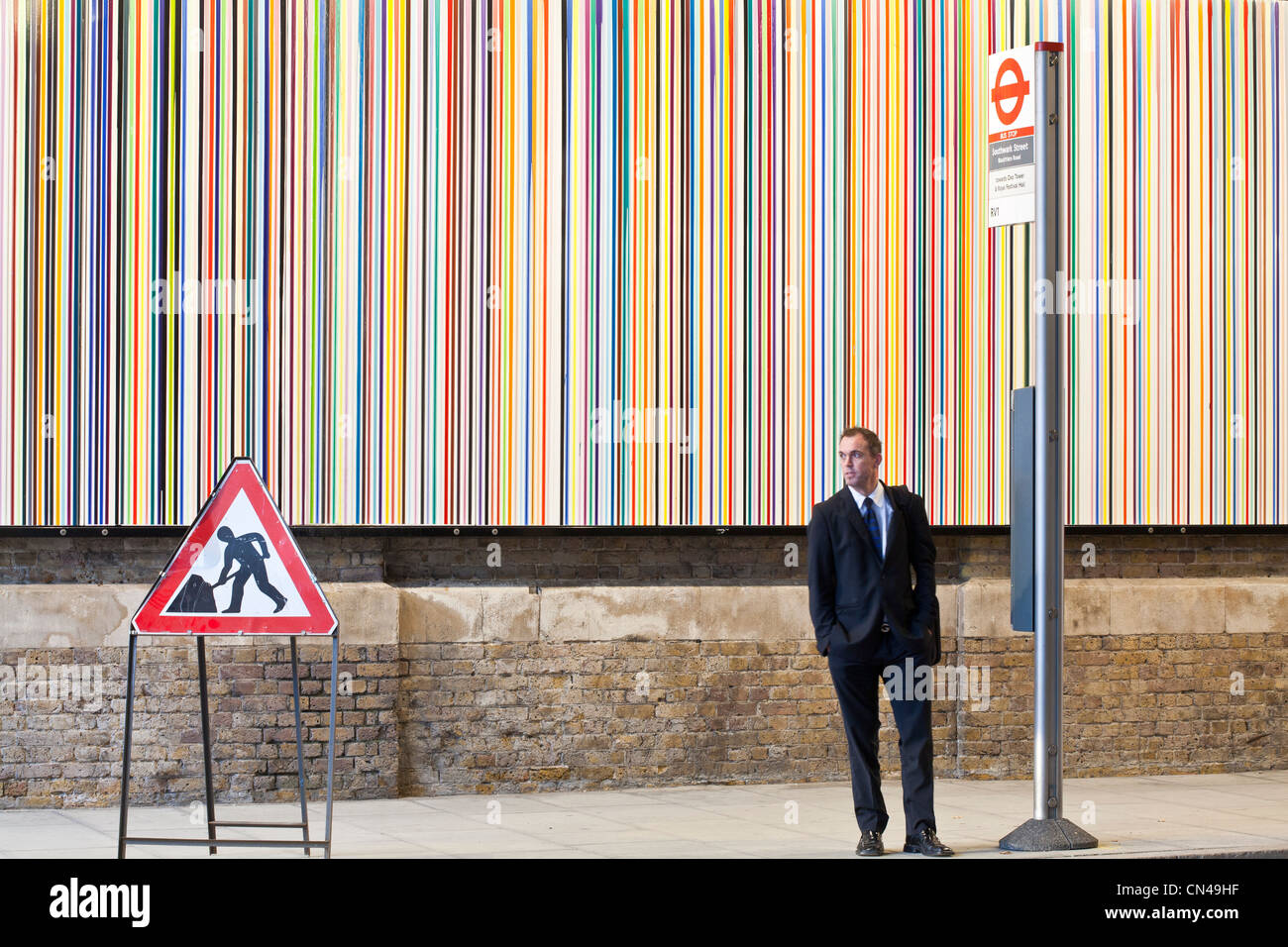 United Kingdom, London, Southwark, Bankside, bus stop in front of artwork called Poured Lines by artist Ian Davenport - Stock Image