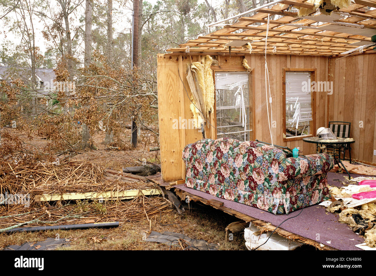 Walls and ceiling of house blown away, exposing living room, aftermath of Hurricane Katrina, Sulphur, USA - Stock Image