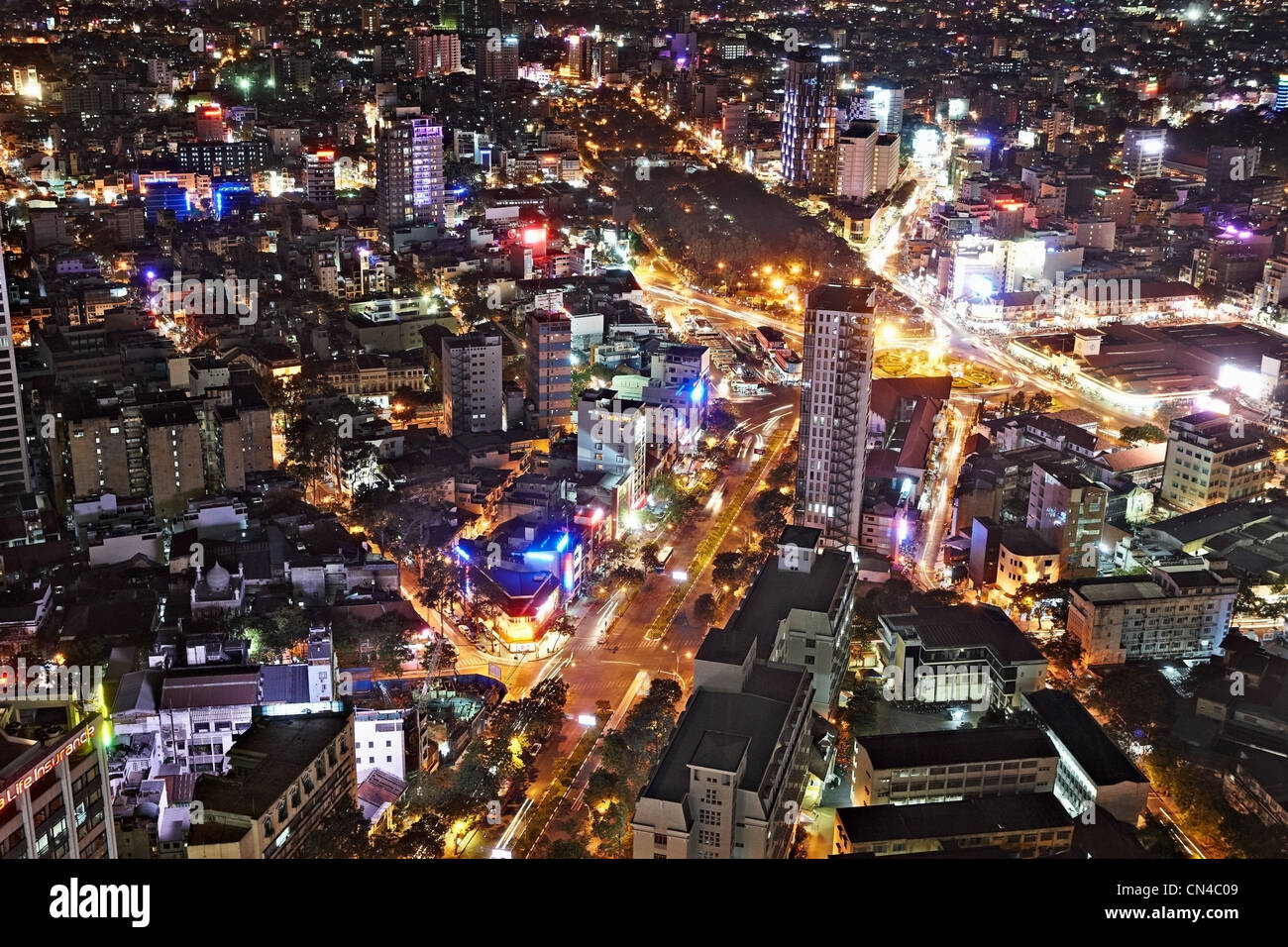 Aerial view of Ho Chi Minh City, District 1 at night with Ben Thanh Market, Vietnam - Stock Image