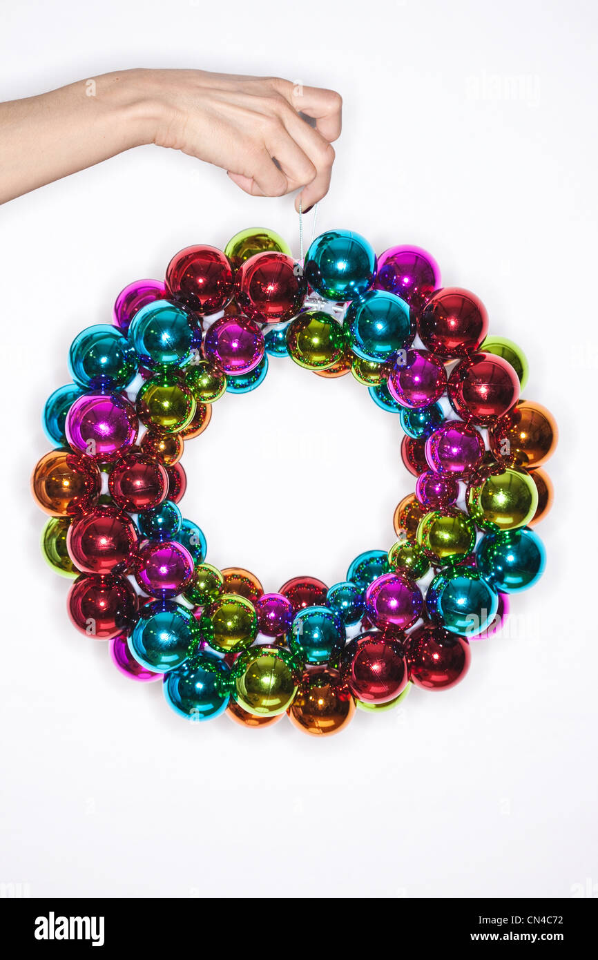 Brightly coloured Christmas baubles - Stock Image