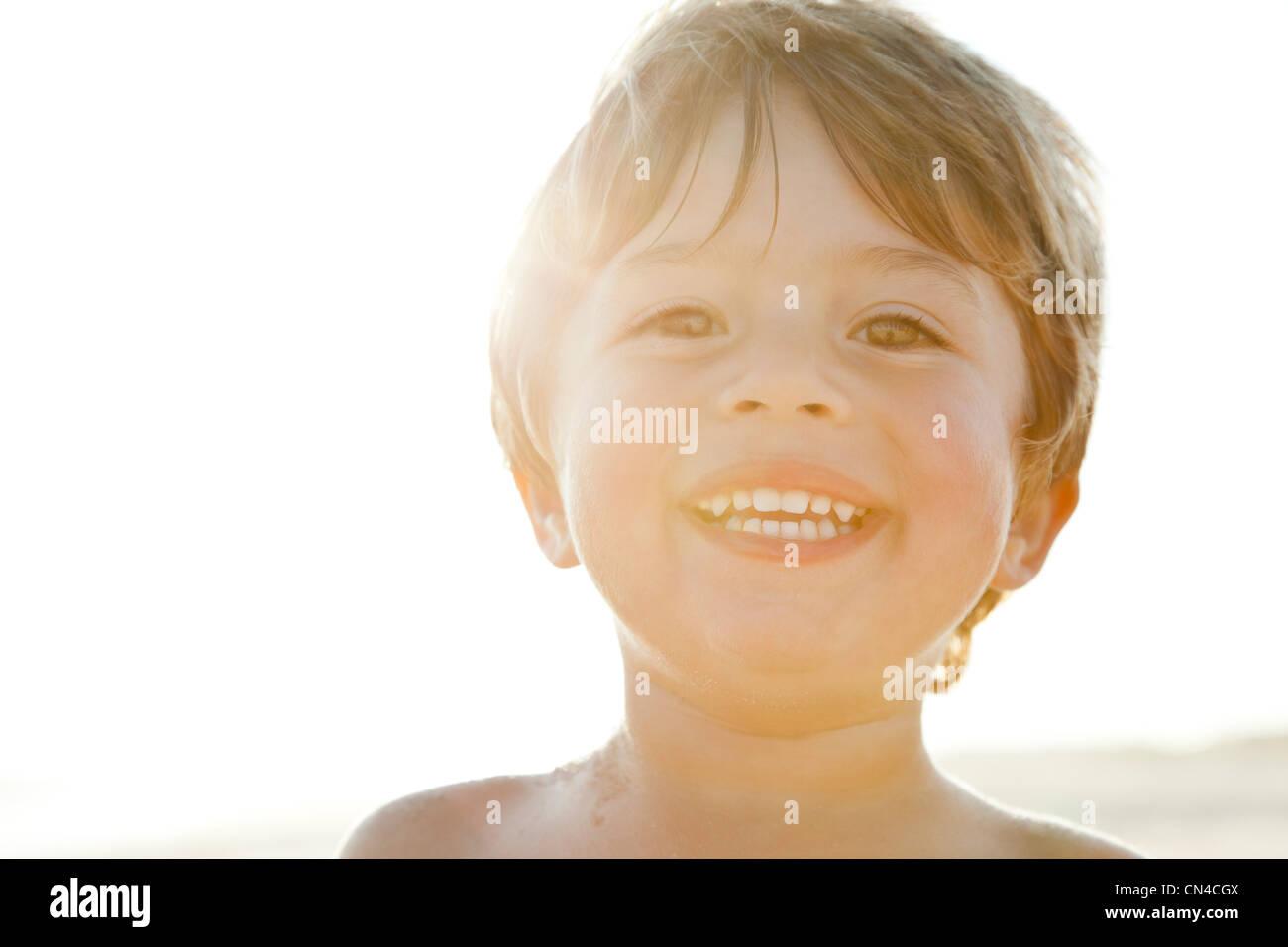 Happy boy in sunlight - Stock Image