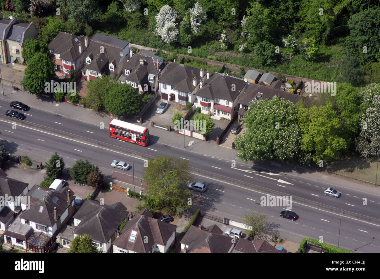 aerial view of a London bus in suburbia - Stock Image