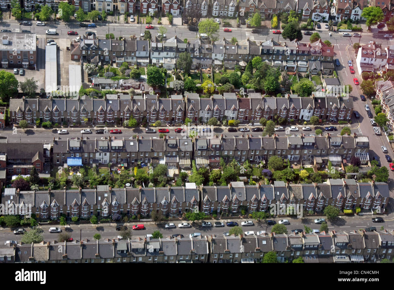 aerial view of tightly packed terraced urban housing in London SW19 - Stock Image