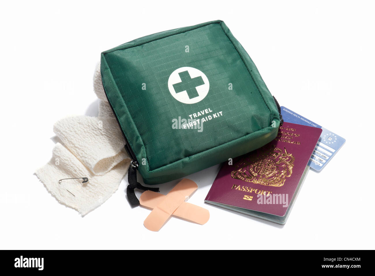 A travel first aid kit, UK passport and European health insurance card - Stock Image