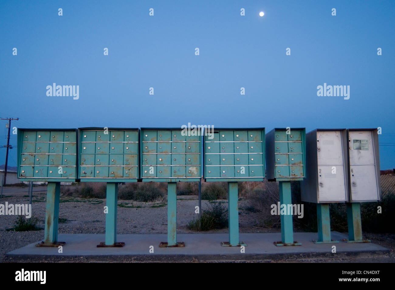 Row of mailboxes at night - Stock Image