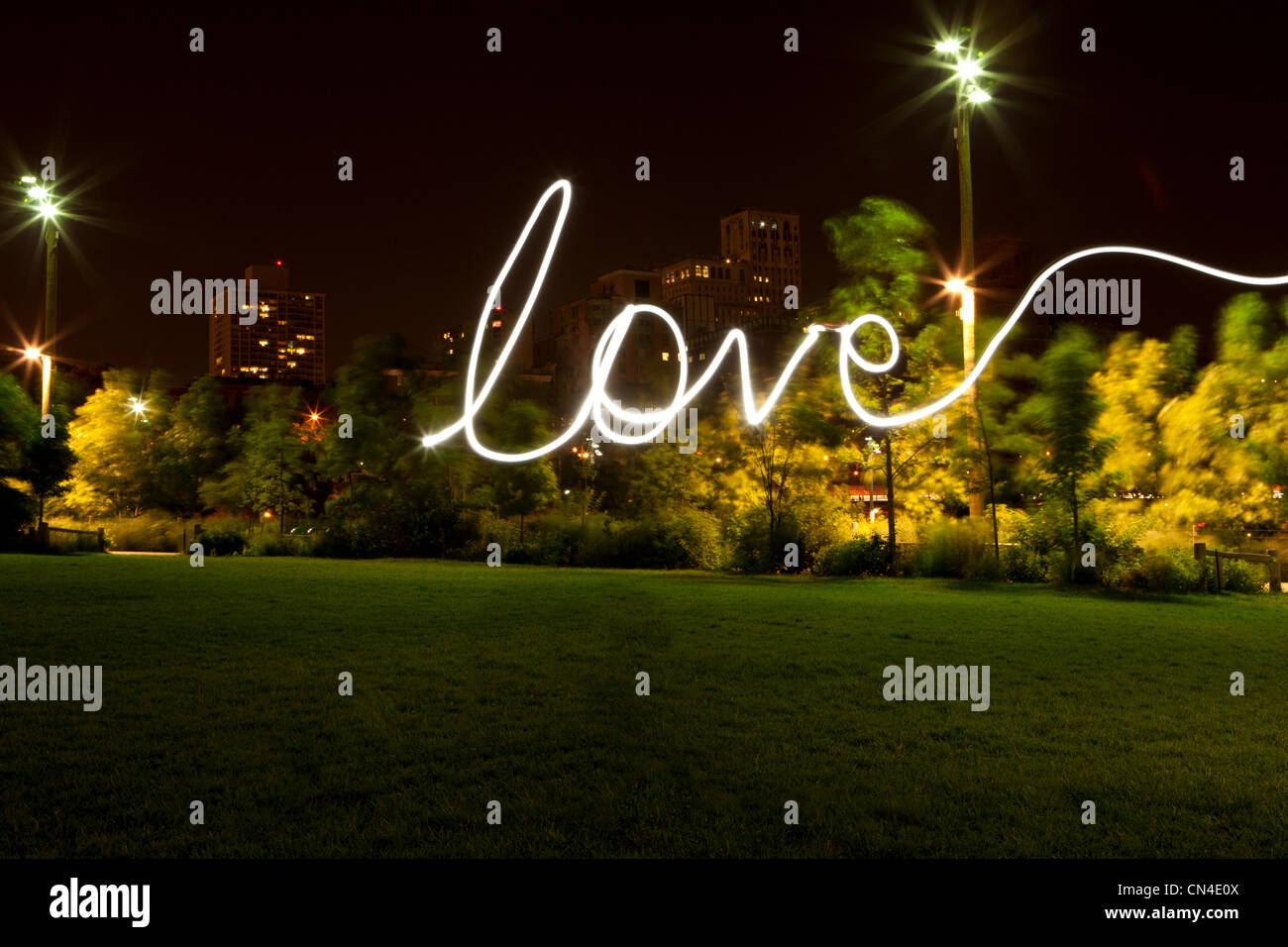 Love written by light trail at night - Stock Image