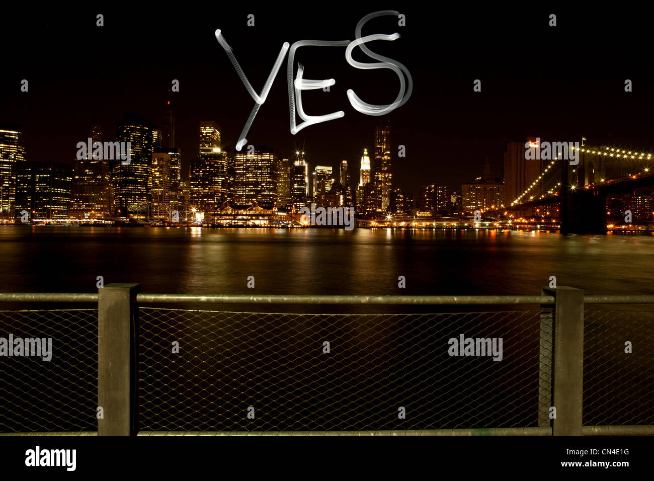 Yes written by light trail at night - Stock Image