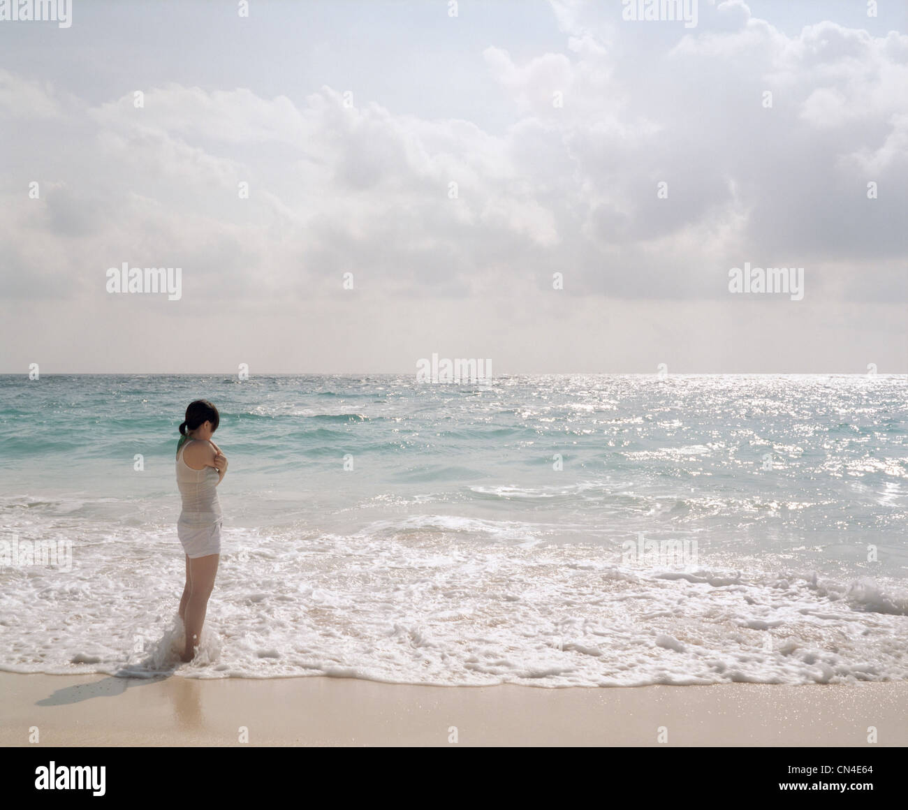 Young woman looking out to sea, Bermuda - Stock Image