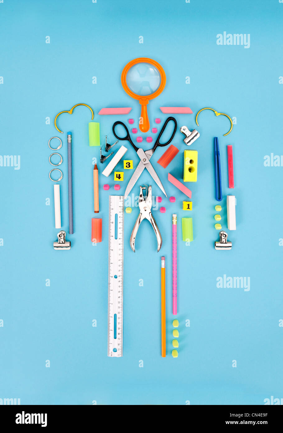 Figure made from stationery - Stock Image