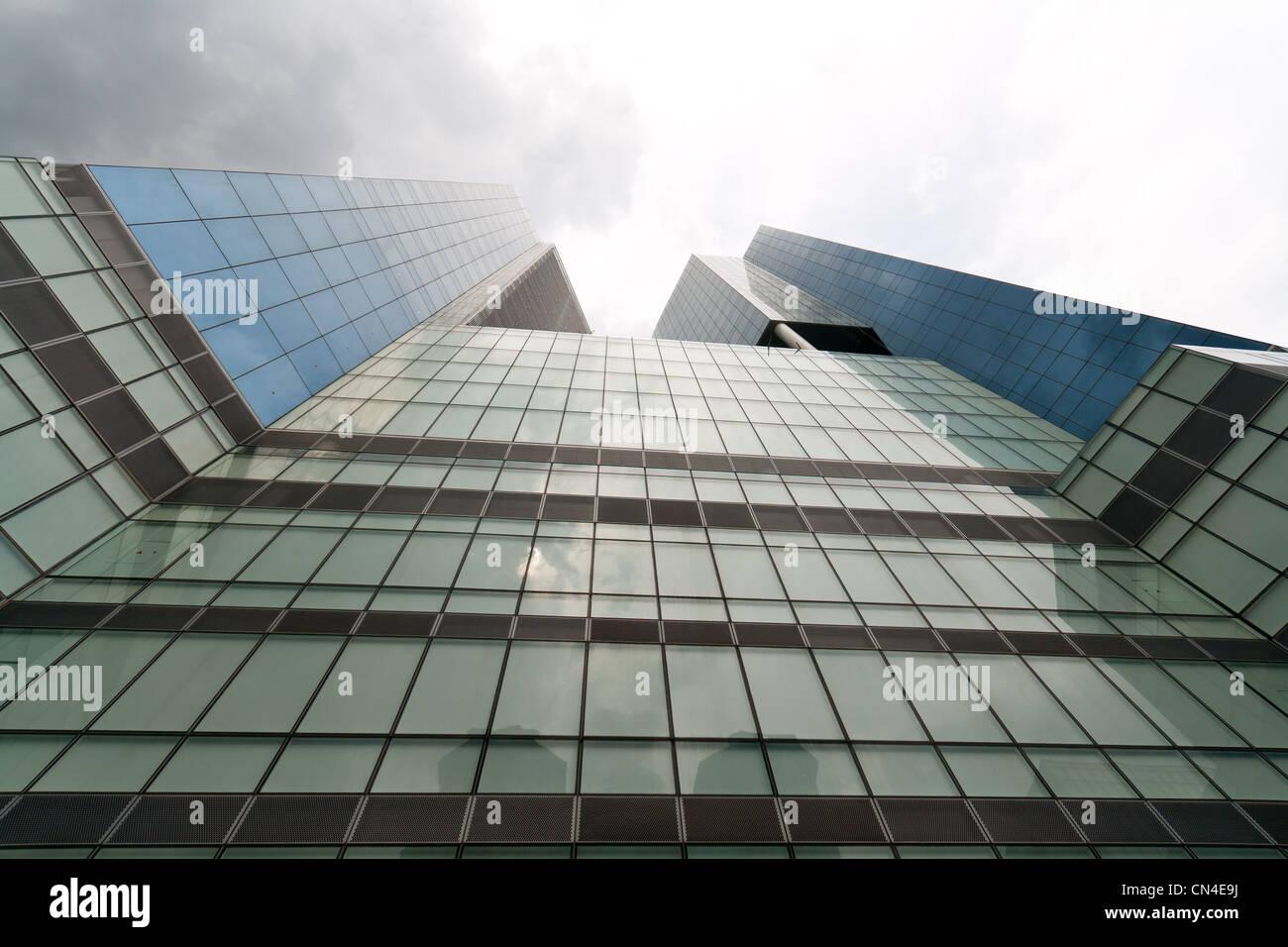Looking upwards an exterior of a modern skyscraper - Stock Image