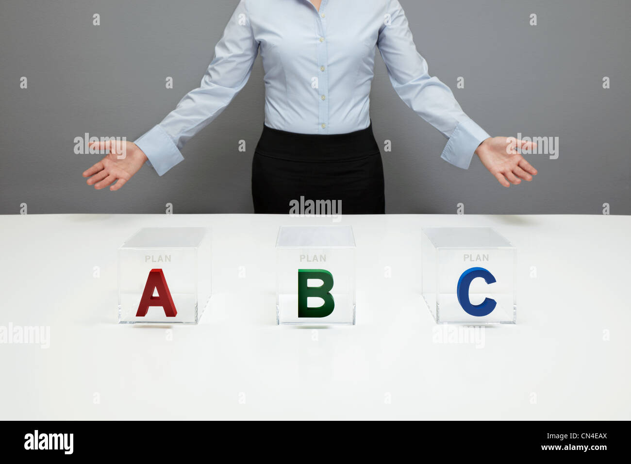Business woman with boxes labelled A,B and C Stock Photo