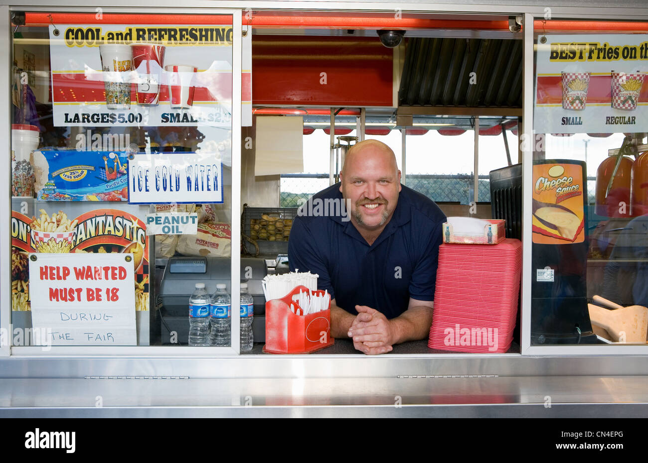 Owner of food stall at county fayre, smiling Stock Photo