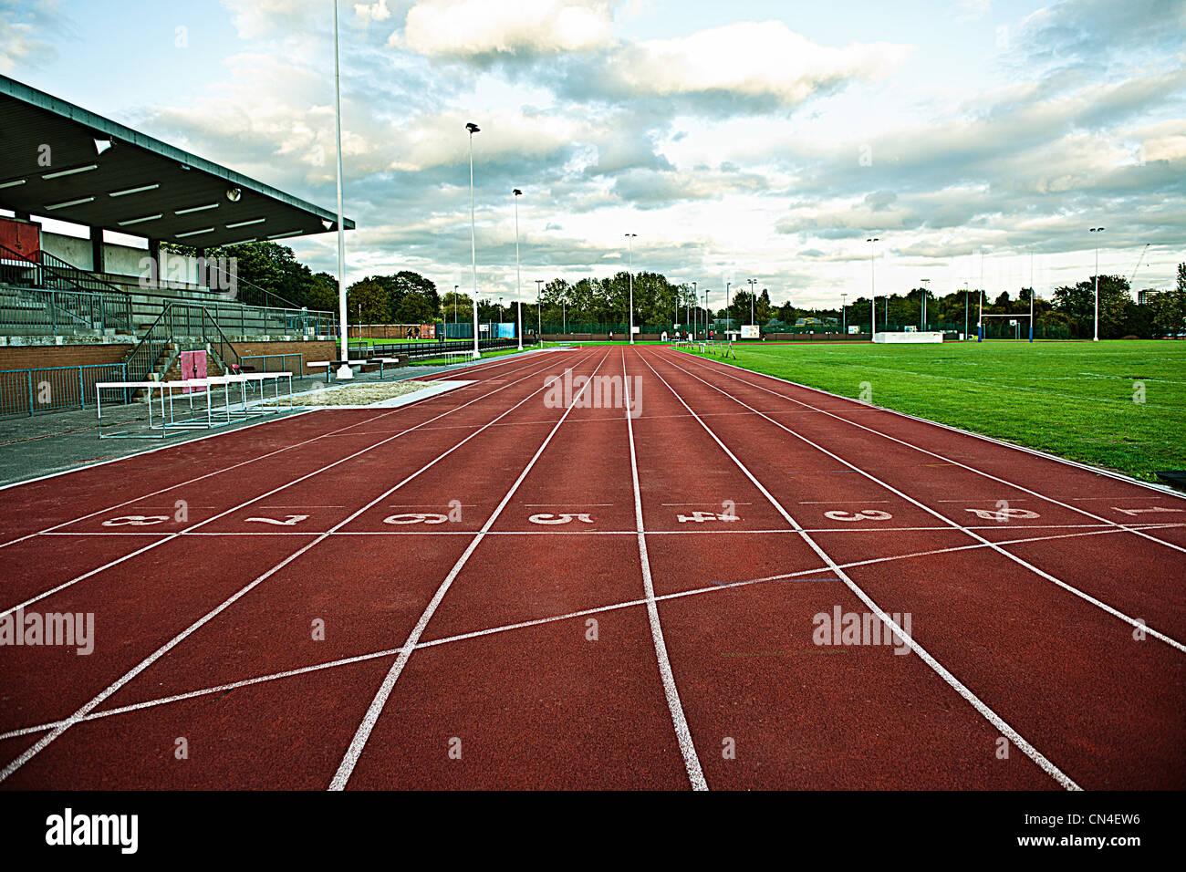Empty sportstrack and stadium - Stock Image